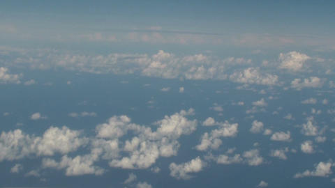 Aerial of clouds over the sea with blue sky Footage