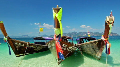 Thai Traditional Wooden Boat At Ocean Shore stock footage