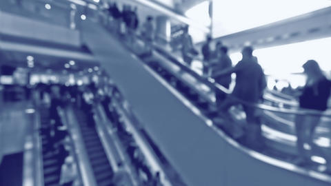 People on moving escalators at modern shopping mall, Hong Kong. Blur effect Footage