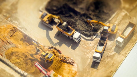 Excavators and tipper tracks at construction. Hong Kong. Time lapse, tilt shift Footage