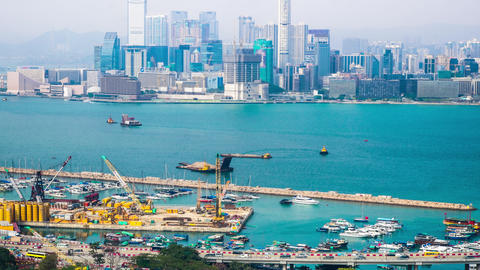 Time lapse aerial panorama view of Hong Kong Island with cargo port terminal Footage