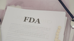 Reading FDA approved medical drugs papers Footage