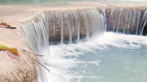 Closeup streaming water of tropical waterfall with original audio Footage