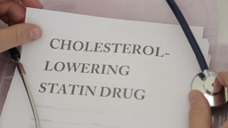 Doctor Holding Cholesterol Lowering Drugs Papers stock footage