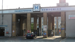 hospital entrance - exterior - cars drive in and drive out - with people Footage