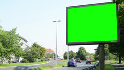 billboard - green screen - urban street with passing cars and buildings with nat Footage