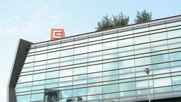 CEZ headquarters (electricity and gas) - modern building - trees with blue sky - Footage