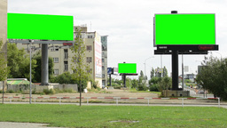 three billboards in the city - green screen - nature (grass) with buildings - cl Footage