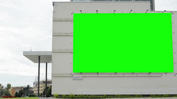 billboard on a building (shopping center) - green screen - with people in backgr Footage