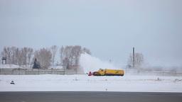 Snowplow clears the runway Footage
