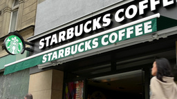 Starbucks Coffe shop (exterior) - people walking on pavement Footage