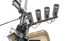 four security cameras on the street - building in background - cloudy Footage