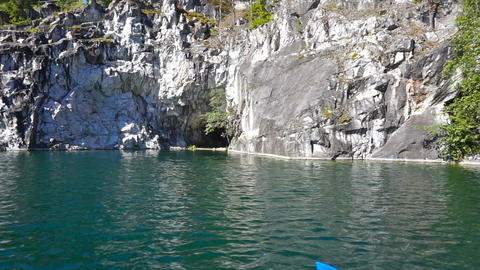 Swimming in marble quarry in Ruskeala, Karelia Footage