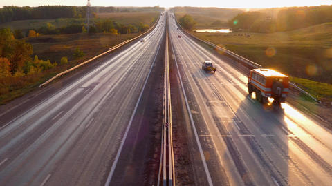 cars traveling on the highway road at sunset, 4k Footage