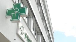 Pharmacy(sign) - Exterior - Cloudy Sky stock footage