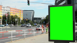 billboard in the city near road and buildings - green screen - people with passi Footage