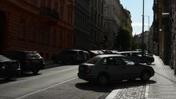 urban street with parked cars - blue sky - sun (sun rays) Footage