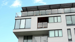 modern building - balcony - windows - blue sky Footage