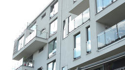 modern building - balcony - windows - sky - fence with nature Footage