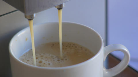 Close-up coffee machine pour espresso in white cup Stock Video Footage