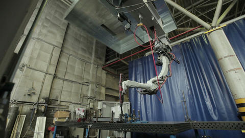 Getting started welding robot. Slide from the gate at the welding robot Footage