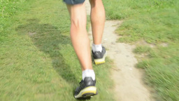man sports - running - detail of legs - man warming up and then start running -  Footage