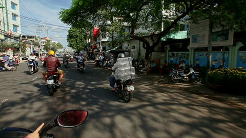 Street with Small Traffic Man on Motorbike Carries Glass Jars Footage