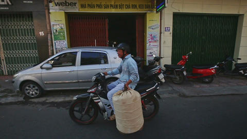 Asian Man Rides Slowly on Motorbike and Carries Bag Footage