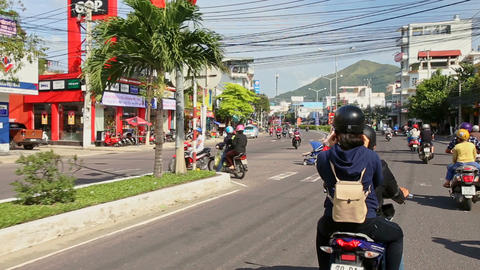 Motorbikes Move along Wide Street on Sunny Day in Vietnam Footage