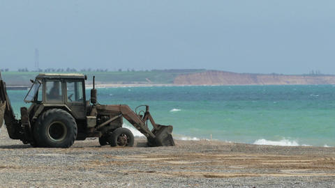 Tractor Working On The Beach Footage