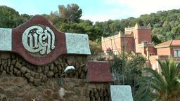 Spain Barcelona 081 Park Güell stone wall and emblem Footage