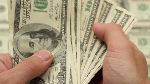 Businessman hands counting hundred US dollar Footage