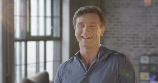 Slow Motion Portrait of Happy Cute Caucasian Man Laughing at Office Room. Busine Footage