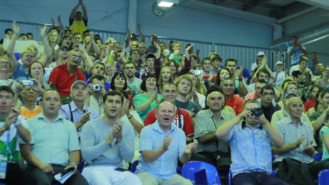 Cheerful Spectators Support Competition Participants on Stands Footage