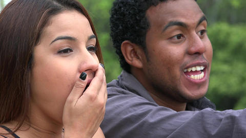 Man Pointing With Excited Woman Live Action