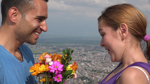 Happy Woman Accepts Flowers From Man Footage