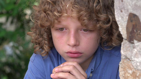 Sad and Angry Boy with Curly Hair Footage