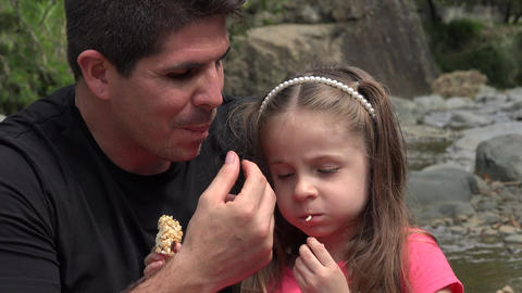 Father And Toddler Daughter Snacking Live Action
