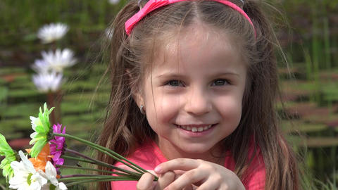 Smiling Toddler Girl Outdoors Live Action