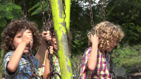 Brothers Playing on Swing Set Footage
