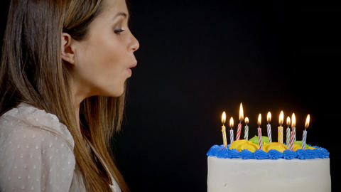 Blowing Out Candles On A Birthday Cake Filmmaterial