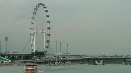 Singapore 060 ferris wheel seen from bayfront promenade Footage