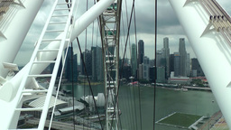 Singapore 018 inside rising cabin of ferris wheel; skyline Footage