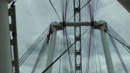 Singapore 030 giant skyferris wheel spokes against cloudy sky Footage