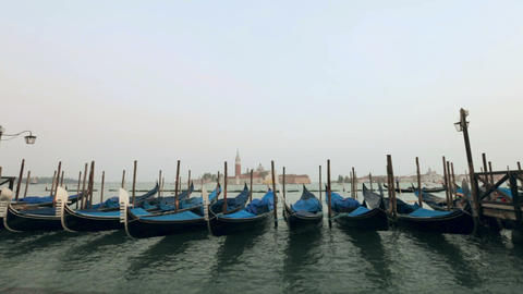 Gondolas sway on the waves in Venice Live Action