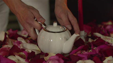 Man taking teapot for romantic tea ceremony. Slow Motion Live Action