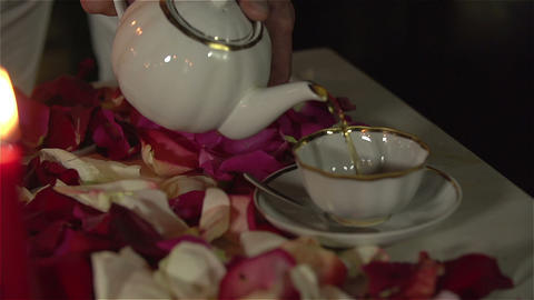 Man filling up cup with tea on romantic tea ceremony.…, Live Action