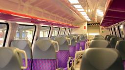 train - interior - seats - door in the background - train window Footage