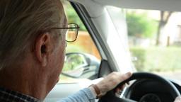 old man(senior) drives a car - head Footage