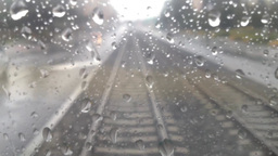 water drops on the window - tram or train - railway line (track or rail) - stone Footage